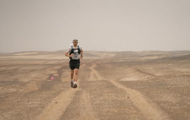 Ben running across sand dunes in Namibia