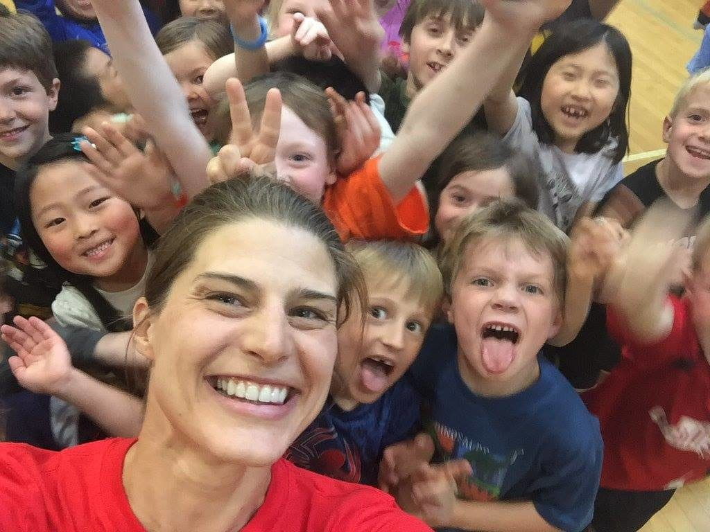 Sarah True with crowd of children