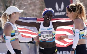Aliphine Tuliamuk of Flagstaff won the U.S. Olympic Marathon Trials women's title Saturday. She celebrates with her Northern Arizona Elite teammates Kellyy Taylor, left, and Stephanie Bruce, who also were in the top 10. (Photo: Kirby Lee/USA TODAY Sports)