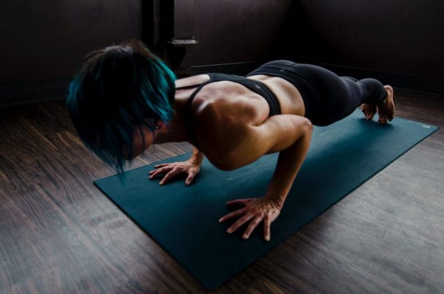 women holding plank home workout