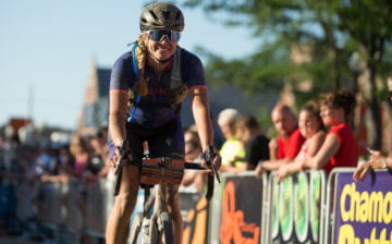 Alison Tetrick on her Specialized gravel bike finishing a race