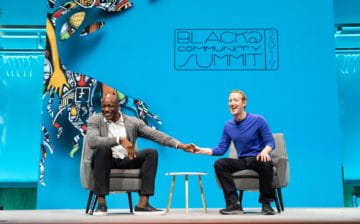 Ime Archibong and Mark Zuckerberg on stage laughing
