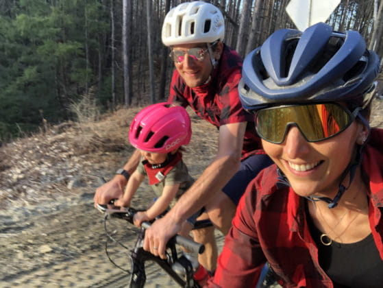 Laura King riding gravel with Ted King and baby Hazel
