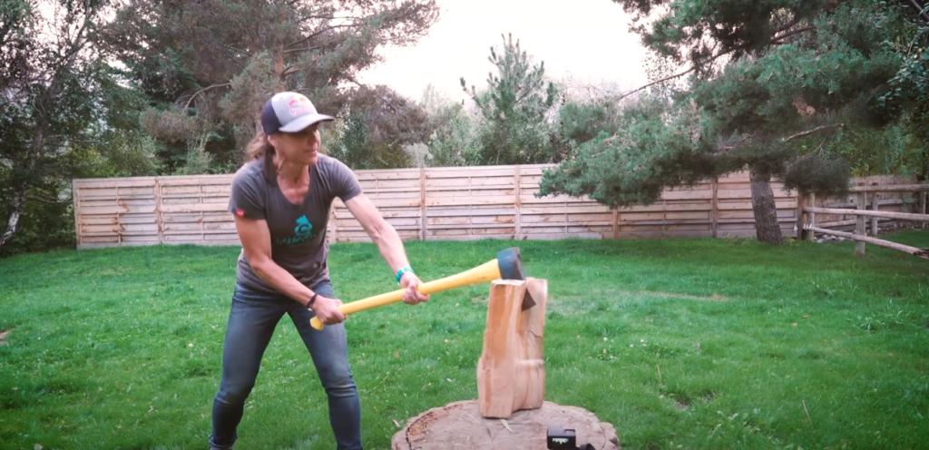 Rebecca Rusch chopping wood in Idaho