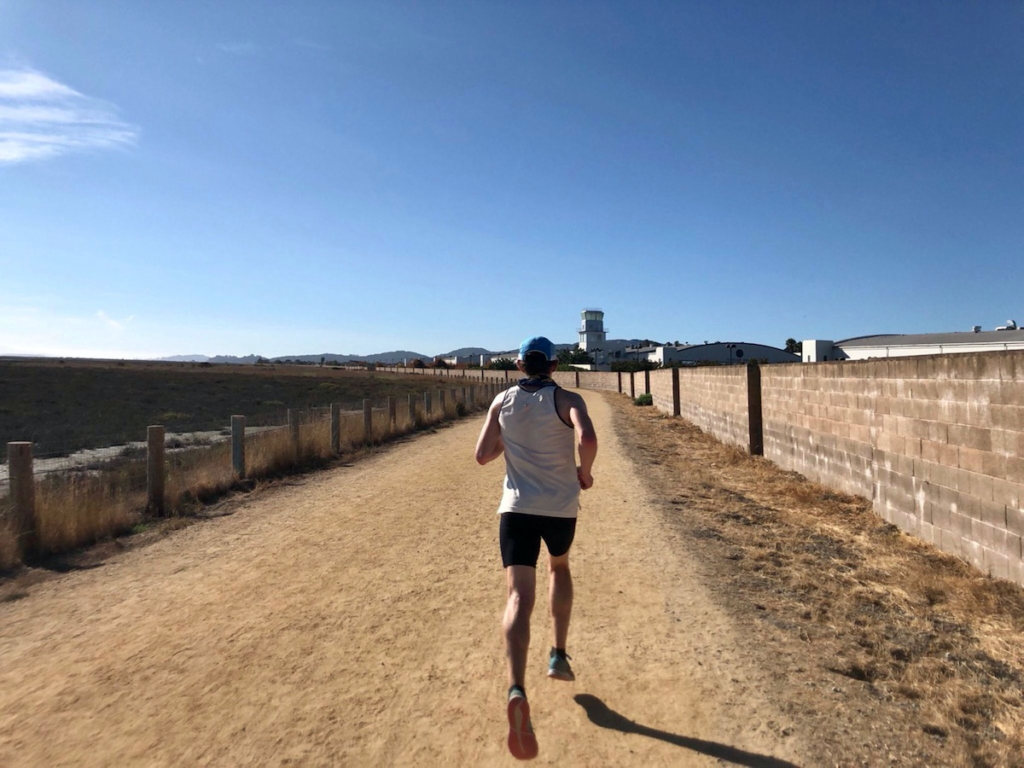 Coach Mario Fraioli on an off-road interval training run