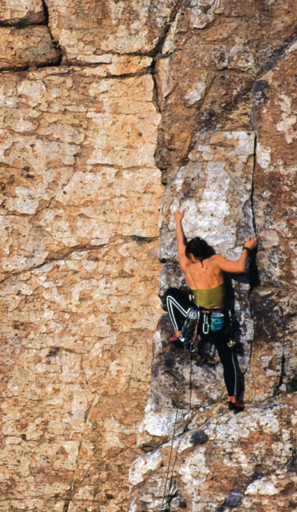 Rebecca Rusch rock climbing