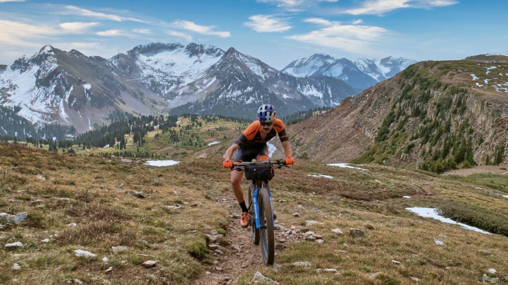 Payson McElveen riding Colorado Trail single track on his mountain bike
