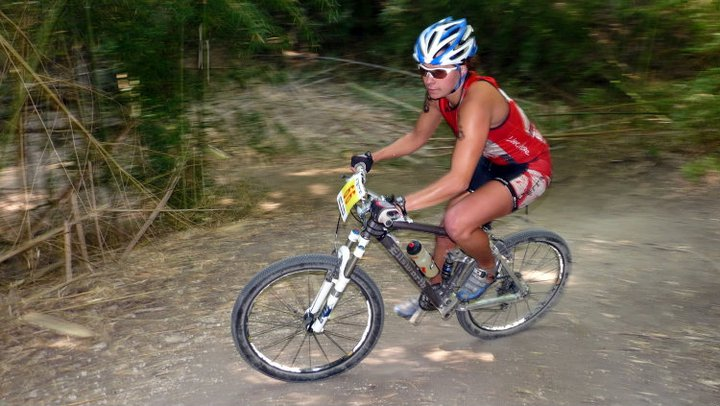 Jess Cerra racing XTERRA on a mountain bike