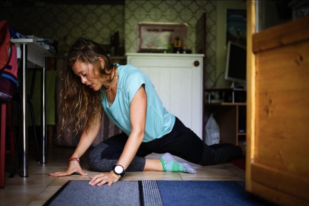 Runner Hillary Allen stretching