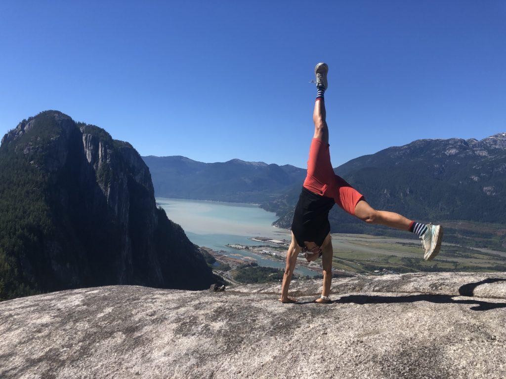 Cyclist Katerina Nash doing a handstand