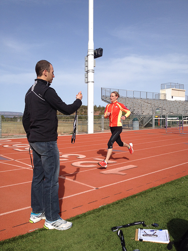 Coach Greg McMillan with an athlete during a track workout